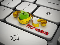 Fitness key on keyboard. Fitness text, apple, tape measure on keyboard Royalty Free Stock Photo