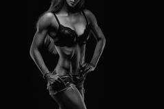 Fitness lady on black Stock Photography