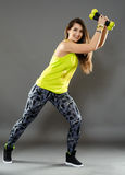 Fitness lady doing cardio dance. Fitness young woman doing cardio aerobic exercises with light dumbbells Royalty Free Stock Photo