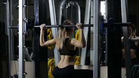 Fitness lady in gym. Workout on gym machine stock video