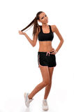Fitness lady pulling her ponytail Royalty Free Stock Images