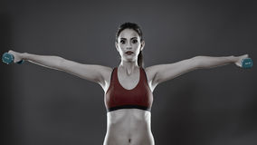 Fitness lady training with dumbbells Royalty Free Stock Image