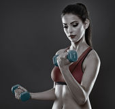 Fitness lady training with dumbbells Royalty Free Stock Photography
