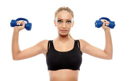 Fitness lady working with dumbbells Stock Images