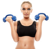 Fitness lady working with dumbbells Royalty Free Stock Photo