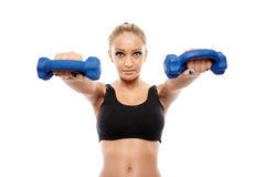 Fitness lady working with dumbbells Royalty Free Stock Photography