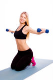 Fitness laughing woman portrait isolated on white background.  Stock Images