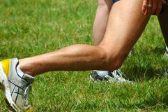 Fitness leg. A white male leg of a caucasian sportsman doing sport and excercising outdoors in nature Royalty Free Stock Photo