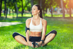 Fitness and lifestyle concept - woman doing sports royalty free stock images