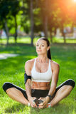 Fitness and lifestyle concept - woman doing sports. Outdoors Stock Image