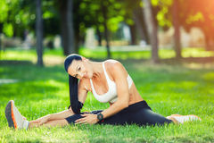 Fitness and lifestyle concept - woman doing sports. Outdoors Stock Photography
