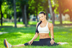 Fitness and lifestyle concept - woman doing sports. Outdoors Royalty Free Stock Image