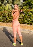 Fitness and lifestyle concept - woman doing sports outdoors.  Stock Photos