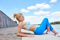 Fitness and lifestyle concept - woman doing sports Stock Photography
