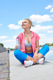 Fitness and lifestyle concept - woman doing sports Royalty Free Stock Photo