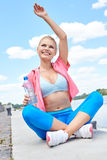 Fitness and lifestyle concept - woman doing sports Royalty Free Stock Image