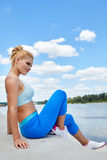 Fitness and lifestyle concept - woman doing sports Stock Photos