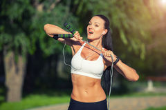 Fitness and lifestyle concept - woman doing sports. Outdoors. girl with skipping rope Stock Photos