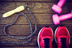 Fitness love concept Top view of sport shoes, dumbbell and jum Royalty Free Stock Photo