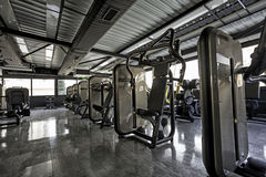 Fitness machines in gym club stock image