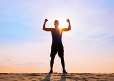 Fitness male athlete with arms up celebrating success and goals. Successful fitness male athlete with arms up celebrating success and goals stock photos