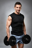Fitness male model with dumbbells Stock Photography