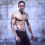 Fitness male model in old garage Stock Photos