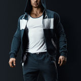Fitness male model in sweatshirt Royalty Free Stock Image