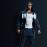 Fitness male model in sweatshirt Royalty Free Stock Photography