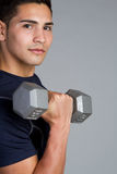 Fitness Man. Fitness workout man lifting dumbbell royalty free stock photo