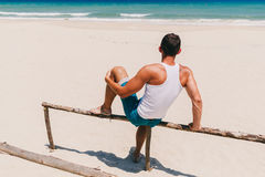 Fitness man on the beach back view Stock Photography