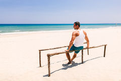 Fitness man on the beach back view Royalty Free Stock Image