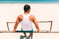 Fitness man on the beach back view Royalty Free Stock Images