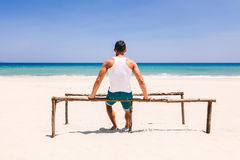 Fitness man on the beach back view Royalty Free Stock Photo