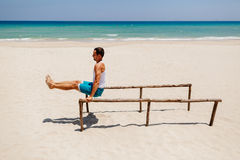 Fitness man on the beach. Fitness handsome man work out on the beach with sea view Stock Photo