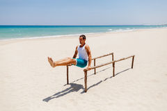 Fitness man on the beach. Fitness handsome man work out on the beach with sea view Stock Images