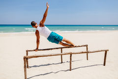 Fitness man on the beach Stock Image