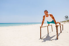 Fitness man on the beach Royalty Free Stock Image
