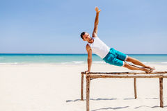 Fitness man on the beach Royalty Free Stock Images