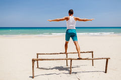 Fitness man on the beach. Fitness handsome man work out on the beach with sea view Royalty Free Stock Photography