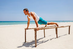 Fitness man on the beach Stock Images