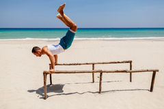 Fitness man on the beach Stock Photography