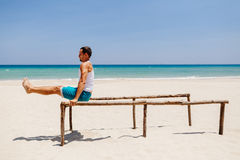 Fitness man on the beach. Fitness handsome man work out on the beach with sea view Stock Image