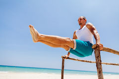 Fitness man on the beach. Fitness handsome man work out on the beach with sea view Royalty Free Stock Images