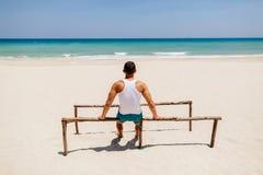 Fitness man on the beach Stock Photos