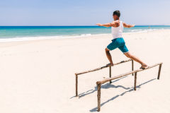 Fitness man on the beach. Fitness sport man on the beach with sea view in tropics Royalty Free Stock Photo