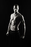 Fitness man on black background stock photography