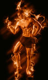 Fitness man on black with fire Stock Images