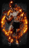 Fitness man on black with fire Stock Photo