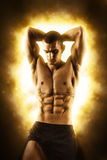 Fitness man on black with fire Royalty Free Stock Image